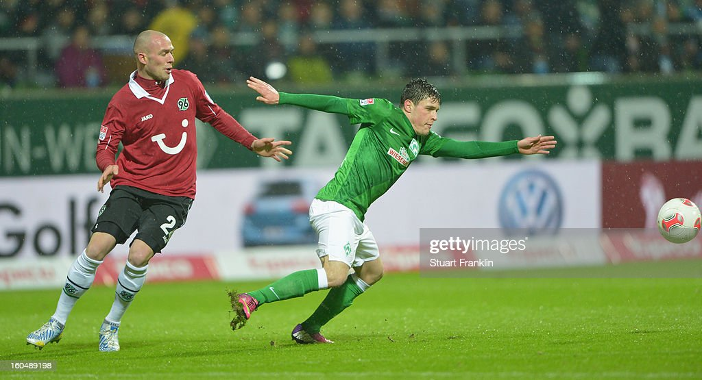 Zlatko Junuzovic of Bremen challenges for the ball with <a gi-track='captionPersonalityLinkClicked' href=/galleries/search?phrase=Sofian+Chahed&family=editorial&specificpeople=656191 ng-click='$event.stopPropagation()'>Sofian Chahed</a> of Hannover during the Bundesliga match between SV Werder Bremen and Hannover 96 at Weser Stadium on February 1, 2013 in Bremen, Germany.
