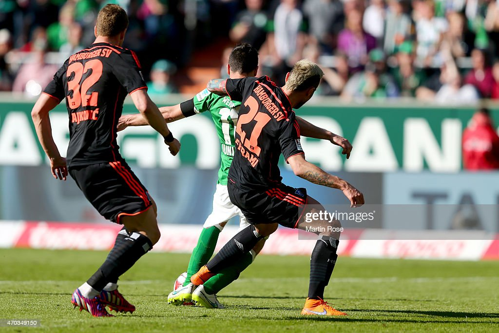 Zlatko Junuzovic of Bremen is attaked by <a gi-track='captionPersonalityLinkClicked' href=/galleries/search?phrase=Valon+Behrami&family=editorial&specificpeople=453450 ng-click='$event.stopPropagation()'>Valon Behrami</a> (R) of Hamburg battle for the ball during the Bundesliga match between SV Werder Bremen and Hamburger SV at Weserstadion on April 19, 2015 in Bremen, Germany.
