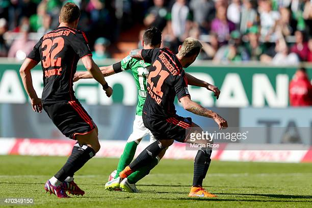 Zlatko Junuzovic of Bremen is attaked by Valon Behrami of Hamburg battle for the ball during the Bundesliga match between SV Werder Bremen and...
