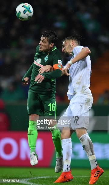Zlatko Junuzovic of Bremen is challenged by Florian Hubner of Hannover during the Bundesliga match between SV Werder Bremen and Hannover 96 at...