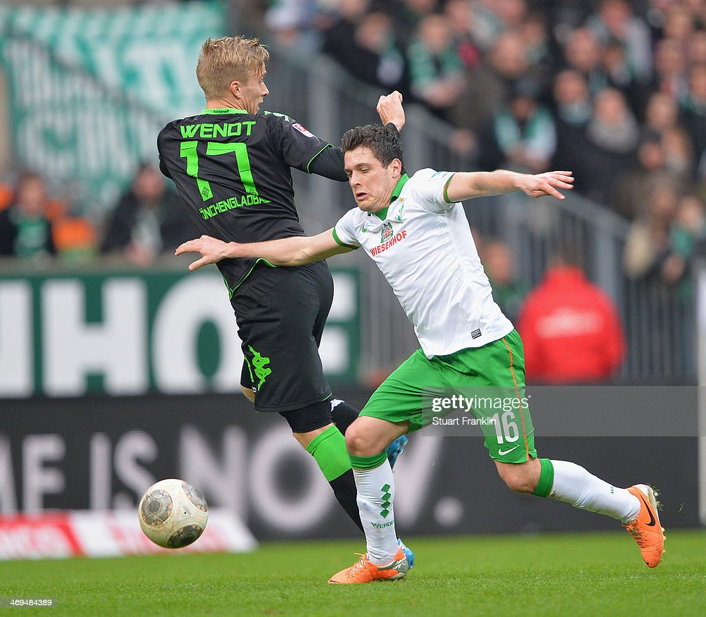 Zlatko Junuzovic of Bremen is challenged by Oscar Wendt of Gladbach during the Bundesliga match between Werder Bremen and Borussia Moenchengladbach at Weserstadion on February 15, 2014 in Bremen, Germany.