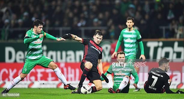 Zlatko Junuzovic of Bremen is challenged by Pascal Grofl of Ingolstadt during the Bundesliga match between Werder Bremen and FC Ingolstadt 04 at...