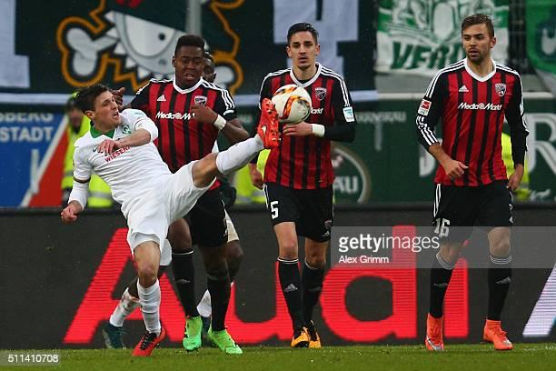 Zlatko Junuzovic of Bremen is challenged by Roger Benjamin Huebner and Lukas Hinterseer of Ingolstadt during the Bundesliga match between FC...