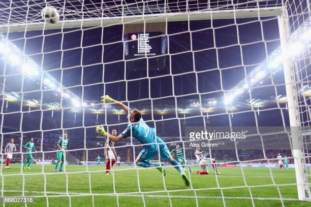 Zlatko Junuzovic of Bremen scores his team's first goal past goalkeeper Lukas Hradecky of Frankfurt during the Bundesliga match between Eintracht...