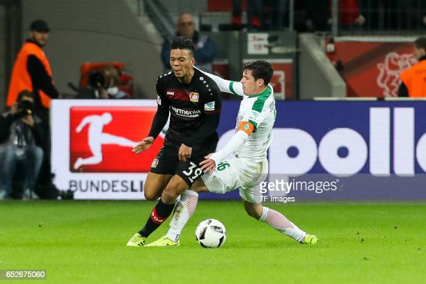 Zlatko Junuzovic of Werder Bremen and Benjamin Henrichs of Leverkusen battle for the ball during the Bundesliga soccer match between Bayer Leverkusen...