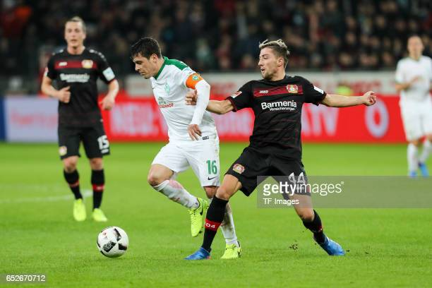 Zlatko Junuzovic of Werder Bremen and Kevin Kampl of Leverkusen battle for the ball during the Bundesliga soccer match between Bayer Leverkusen and...