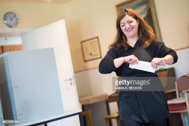 Özlem Alev Demirel top candidate of the leftwing 'Die Linke' party for regional elections in North RhineWestphalia casts her ballot at a polling...