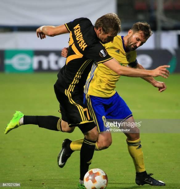 Zlin's Czech midfielder Petr Jiracek and FC Sheriff's midfielder from Belarus Yuri Kendysh vie for the ball during the UEFA Europa League group F...