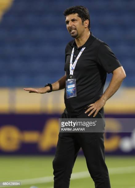 Zob Ahan's coach Mojtaba Hoseini gestures during an Asian Champions League football match between Iran's Zob Ahan club and Saudi Arabia's AlAhli club...