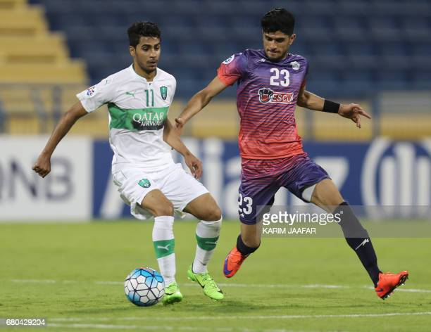 Zob Ahan's Danial Mehdi Esmaeilifar fights for the ball with alAhli's Hussain Al Mogahwi during their Asian Champions League football match between...
