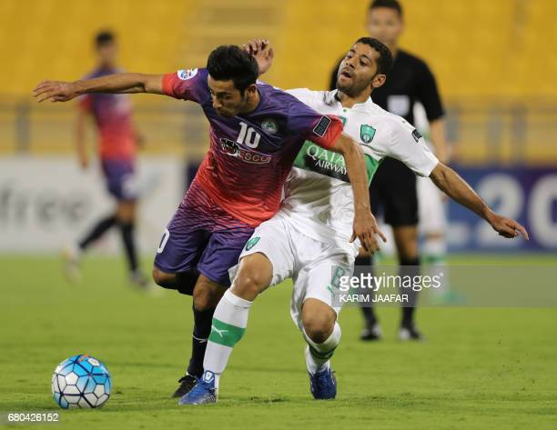 Zob Ahan's Ehsan Pahlevan fights for the ball with alAhli's Taisir Al Jassim during their Asian Champions League football match between Iran's Zob...