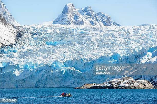 Zodiac boat in front of a glacier in Greenland