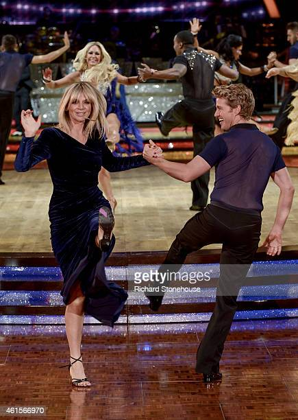 Zoe Ball dances with Kevin Clifton during a photocall to launch the Strictly Come Dancing Live Tour 2015 at Birmingham Barclaycard Arena on January...