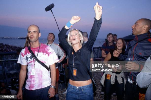 Zoe Ball watches her husband Fatboy Slim performing at Big Beach Boutique 1 Brighton Beach United Kingdom 2002