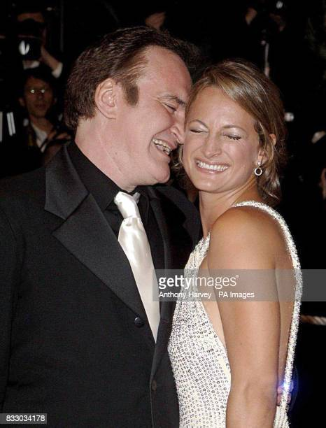 Zoe Bell and Quentin Tarantino arrive for the screening of 'Death Proof' during the 60th annual Cannes Film Festival in Cannes France