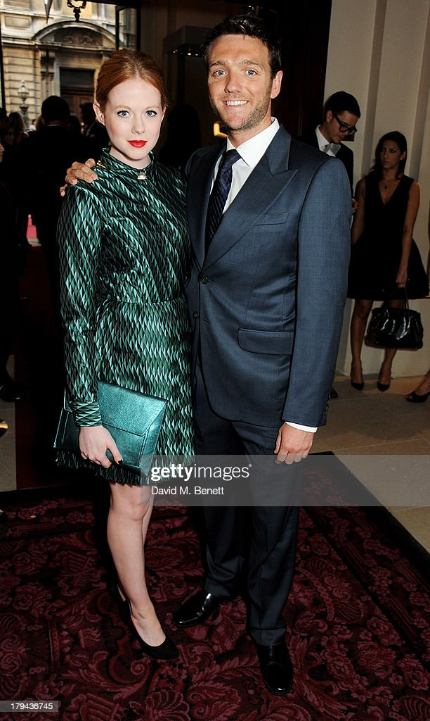 Zoe Boyle (L) arrives at the GQ Men of the Year awards at The Royal Opera House on September 3, 2013 in London, England.