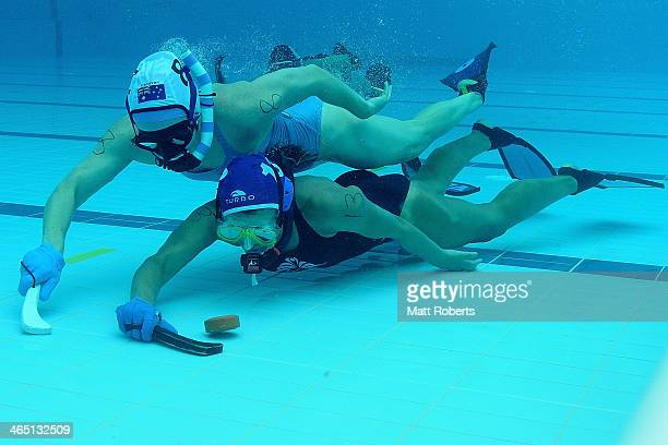 Zoe Canavan of Victoria and Jane Gilligan of New South Wales contest for the puck during the 2014 Australian Underwater Hockey Championships at Palm...