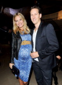 Zoe Cole and Brendan Cole attend as Burberry celebrates The Britain at Burberry Regent Street on October 2 2012 in London England