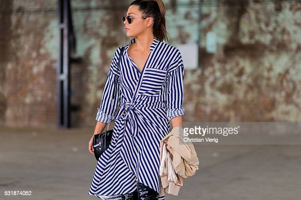 Zoe Grant wearing a blue white striped dress from Shakuhachi and black overknees outside Bec Bridge at MercedesBenz Fashion Week Resort 17...