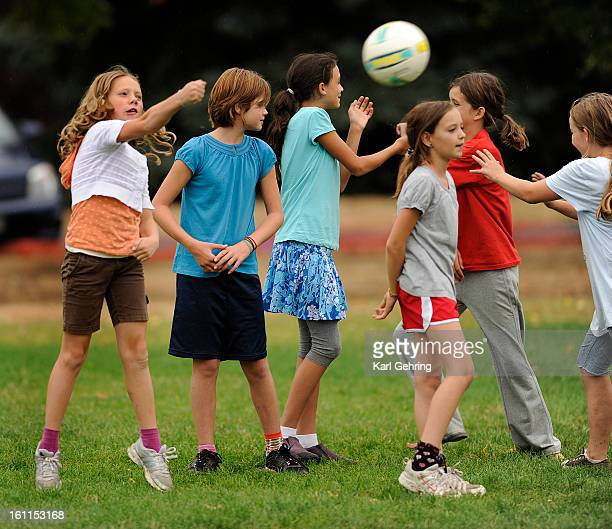 Zoe Gustafson age 11 left and other members of the Denver Waldorf School's Middle School volleyball team practiced their skills in Congress Park in...