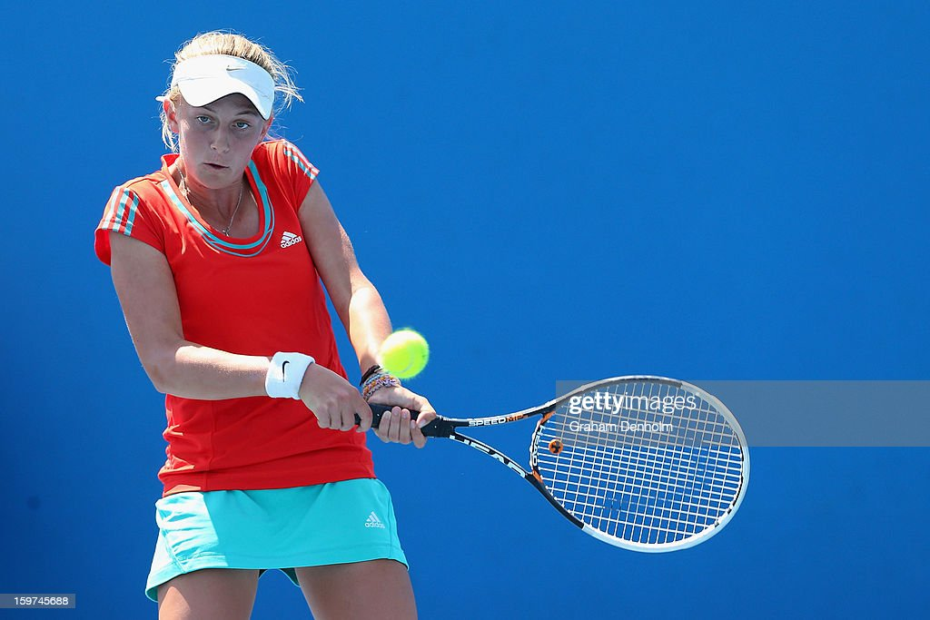 Zoe Hives of Australia plays a backhand in her first round match against Sandra Samir of Egypt during the 2013 Australian Open Junior Championships at Melbourne Park on January 20, 2013 in Melbourne, Australia.