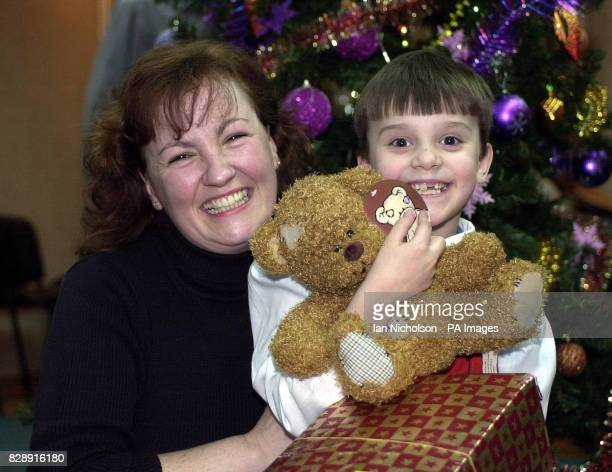 Zoe one of the children at the Zuzino street shelter in Moscow receives a visit from aid worker Marion McCullum from Glasgow on the Russian Christmas...