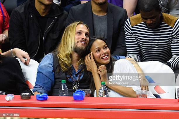 Zoe Saldana and her husband Marco Perego attend a basketball game between Washington Wizards and the Los Angeles Clippers at Staples Center on March...