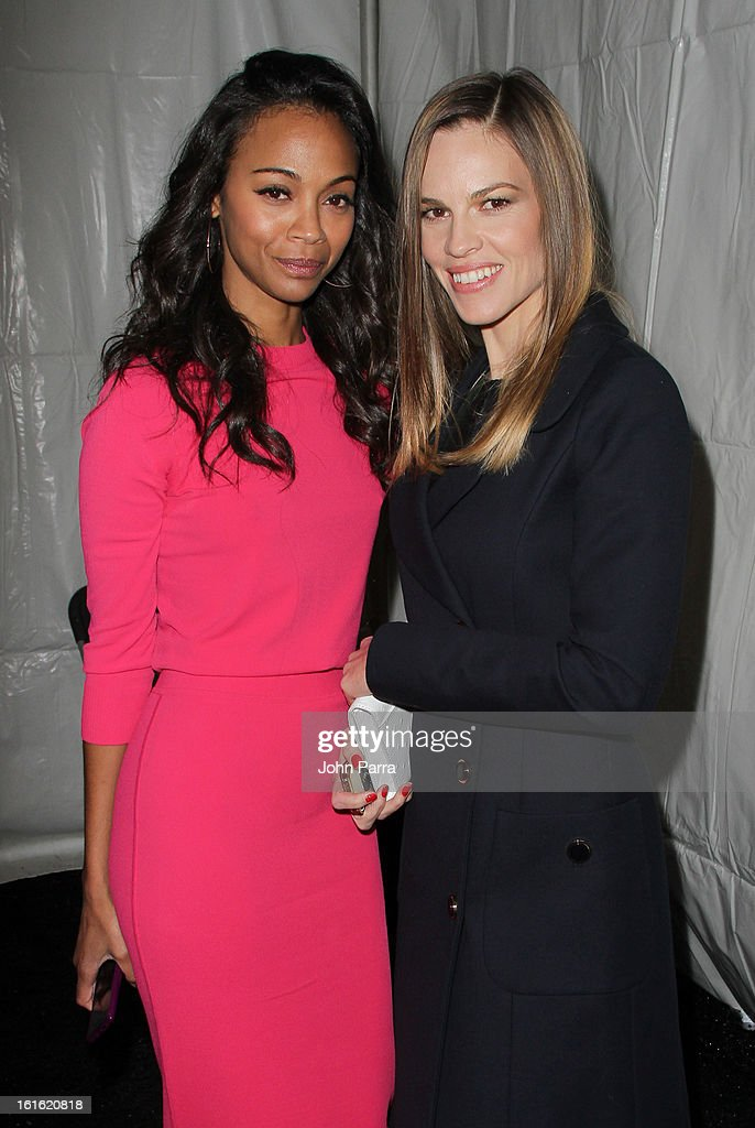 <a gi-track='captionPersonalityLinkClicked' href=/galleries/search?phrase=Zoe+Saldana&family=editorial&specificpeople=542691 ng-click='$event.stopPropagation()'>Zoe Saldana</a> and <a gi-track='captionPersonalityLinkClicked' href=/galleries/search?phrase=Hilary+Swank&family=editorial&specificpeople=201692 ng-click='$event.stopPropagation()'>Hilary Swank</a> are seen during Fall 2013 Mercedes-Benz Fashion Week at Lincoln Center for the Performing Arts on February 13, 2013 in New York City.