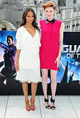 Zoe Saldana and Karen Gillan attends the 'Guardians of the Galaxy' photocall on July 25 2014 in London England