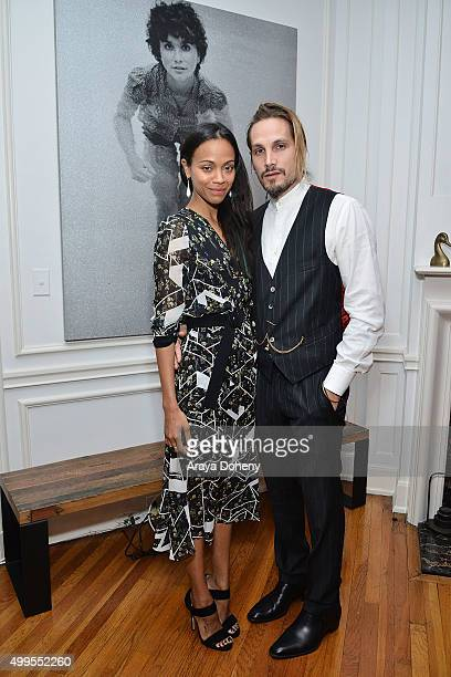 Zoe Saldana and Marco Perego attend The Art of Elysium celebrates the work of Jared Lehr at The Talmadge on December 1 2015 in Los Angeles California