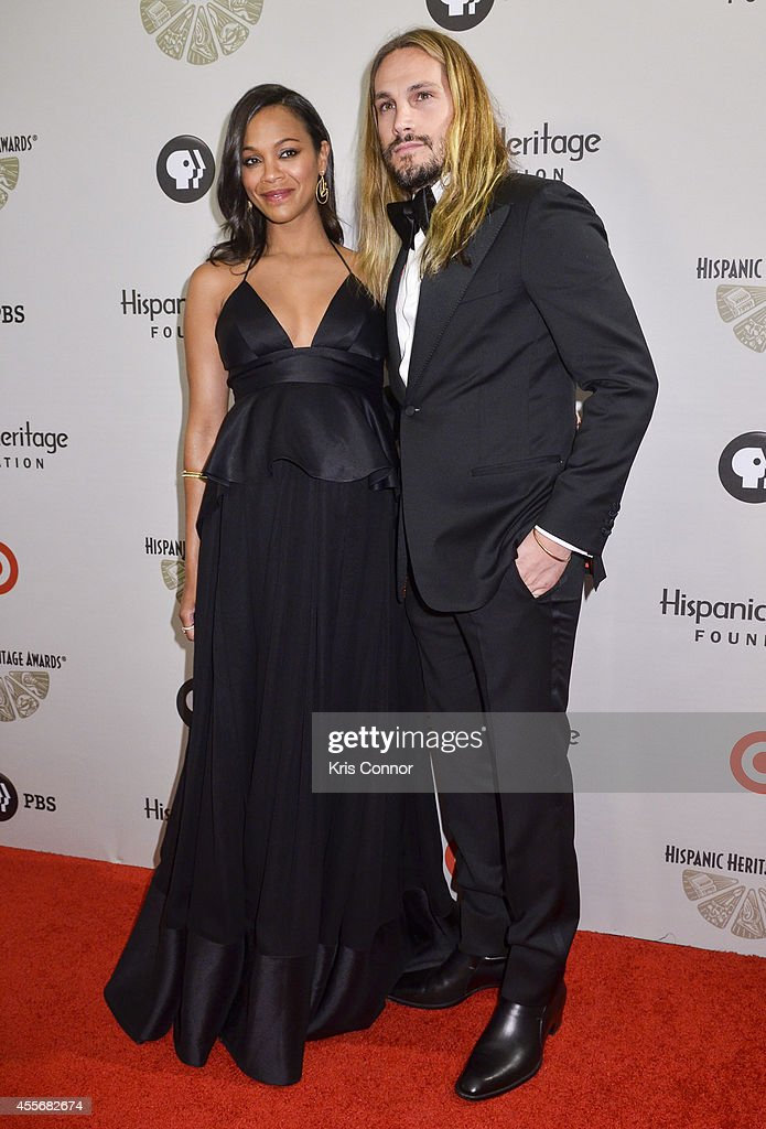 Zoe Saldana and Marco Perego pose on the red carpet during the 2014 Hispanic Heritage Awards at Warner Theatre on September 18 2014 in Washington DC