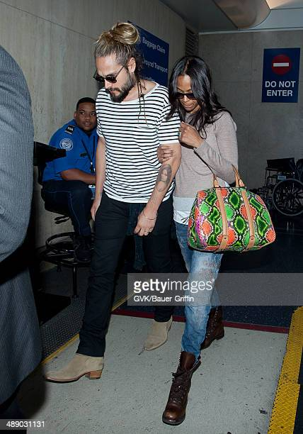 Zoe Saldana and Marco Perego seen at LAX on May 09 2014 in Los Angeles California