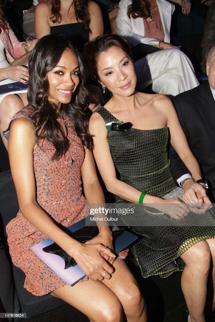Zoe Saldana and Michele Yeoh attend the Giorgio Armani Prive HauteCouture Show as part of Paris Fashion Week Fall / Winter 2012/13 at Palais de...