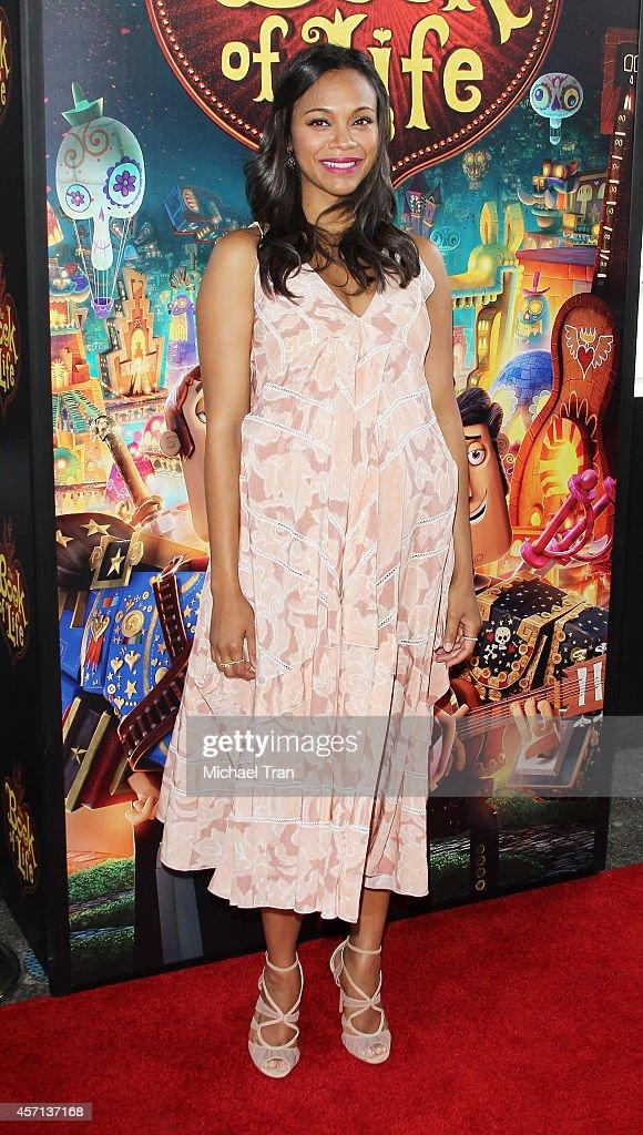 Zoe Saldana arrives at the Los Angeles premiere of 'Book Of Life' held at Regal Cinemas LA Live on October 12 2014 in Los Angeles California
