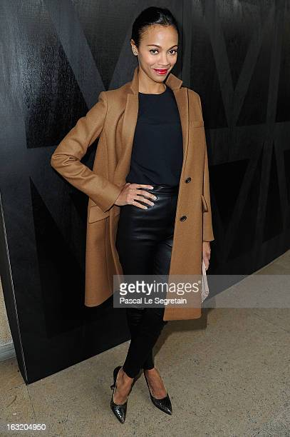 Zoe Saldana attends the Miu Miu Fall/Winter 2013 ReadytoWear show as part of Paris Fashion Week on March 6 2013 in Paris France
