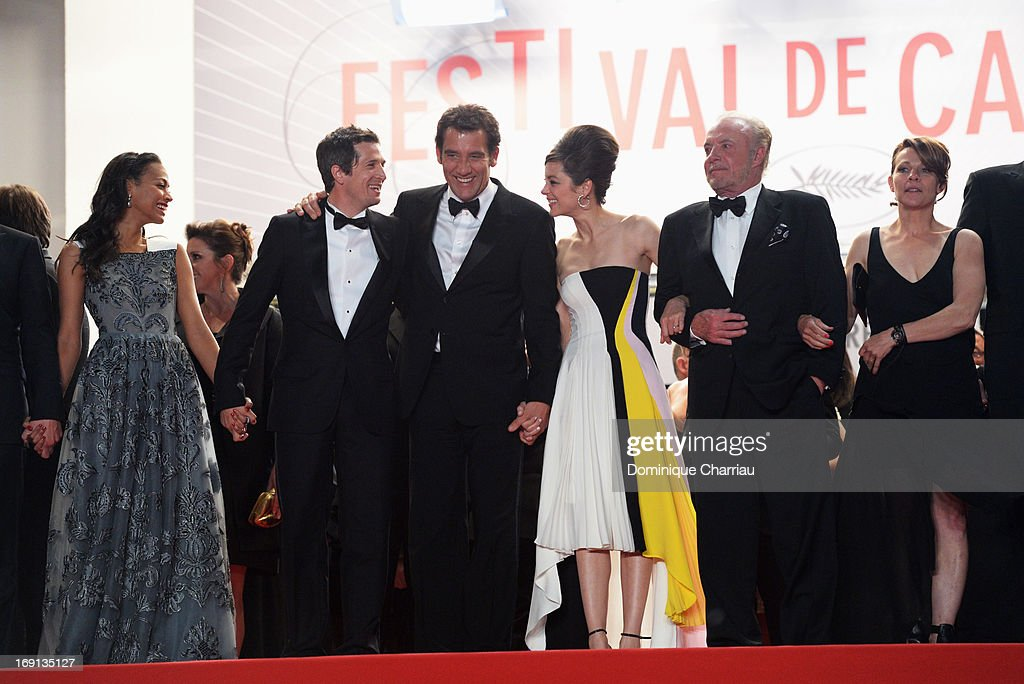 Zoe Saldana, director Guillaume Canet, Clive Owen, Marion Cotillard and James Caan leave the Premiere of 'Blood Ties' during the 66th Annual Cannes Film Festival at the Palais des Festivals on May 20, 2013 in Cannes, France.