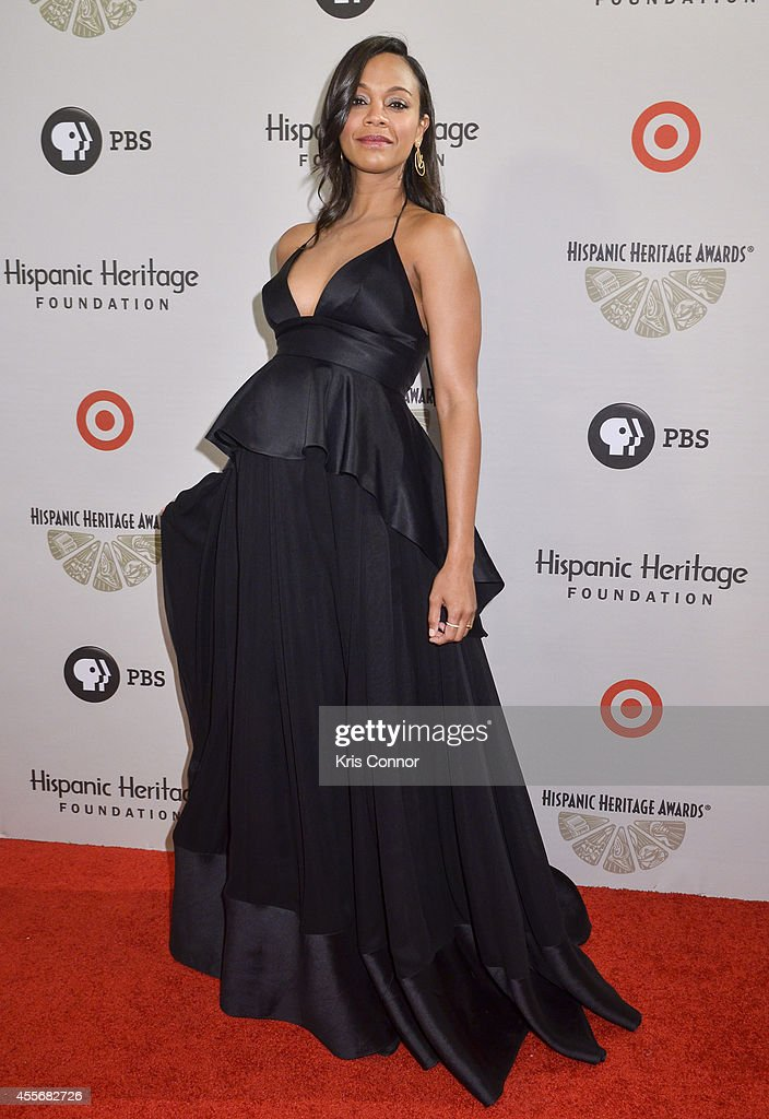 Zoe Saldana poses on the red carpet during the 2014 Hispanic Heritage Awards at Warner Theatre on September 18 2014 in Washington DC