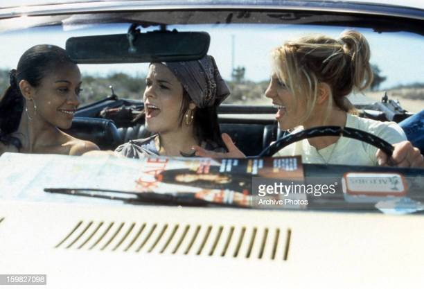 Zoe Saldana Taryn Manning and Britney Spears riding in car in a scene from the film 'Crossroads' 2002