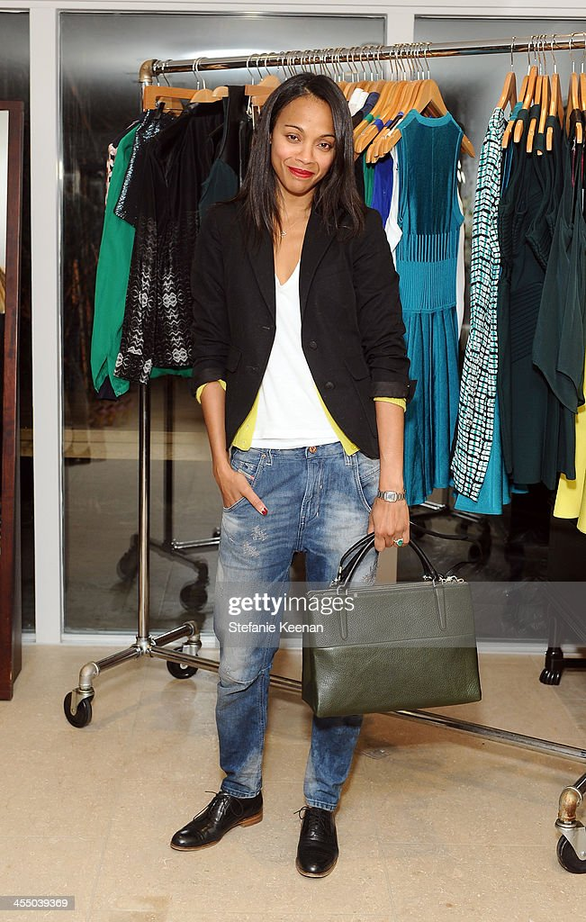 <a gi-track='captionPersonalityLinkClicked' href=/galleries/search?phrase=Zoe+Saldana&family=editorial&specificpeople=542691 ng-click='$event.stopPropagation()'>Zoe Saldana</a> wearing a Coach bag attends A Parker Party on December 10, 2013 in Los Angeles, California.