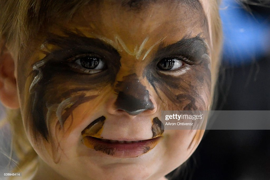Zoe Schnepf, 3, shows her Chewbacca face paint during a Star Wars themed day at Wings Over the Rockies on Sunday, May 1, 2016.