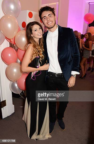 Zoe Sugg and Alfie Deyes attend YouTube phenomenon Zoe Sugg's launch of her debut beauty collection at 41 Portland Place on September 25 2014 in...