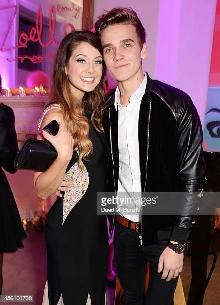 Zoe Sugg and brother Joe Sugg aka Thatcherjoe attend YouTube phenomenon Zoe Sugg's launch of her debut beauty collection at 41 Portland Place on...