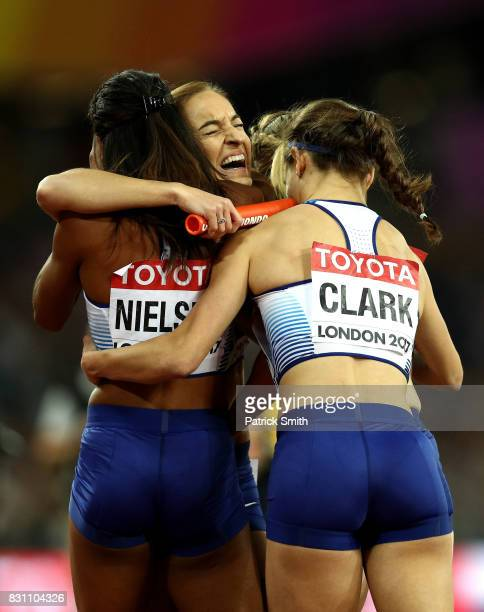 Zoey Clark Laviai Nielsen Eilidh Doyle and Emily Diamond of Great Britain celebrate winning silver in the Women's 4x400 Metres Relay final during day...