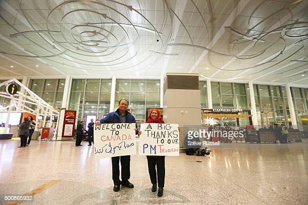 Zohair and Aezaz Khan came up to the airport to show support for the refugees and for the government Syrian refugees begin to arrive in Canada at...