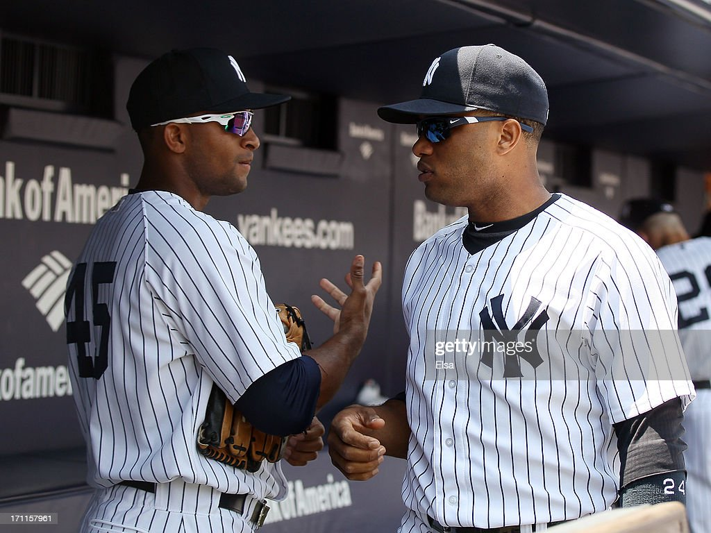 Zoilo Almonte #45 and <a gi-track='captionPersonalityLinkClicked' href=/galleries/search?phrase=Robinson+Cano&family=editorial&specificpeople=538362 ng-click='$event.stopPropagation()'>Robinson Cano</a> #24 of the New York Yankees get ready for the game against the Tampa Bay Rays on June 22,2013 at Yankee Stadium in the Bronx borough of New York City.