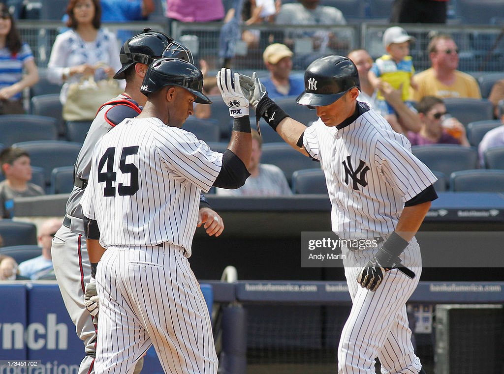 Zoilo Almonte #45 of the New York Yankees congratulates <a gi-track='captionPersonalityLinkClicked' href=/galleries/search?phrase=Ichiro+Suzuki&family=editorial&specificpeople=201556 ng-click='$event.stopPropagation()'>Ichiro Suzuki</a> #31 after Suzuki hit a solo home run in the bottom of the seventh inning against the Minnesota Twins at Yankee Stadium on July 14, 2013 in the Bronx borough of New York City.