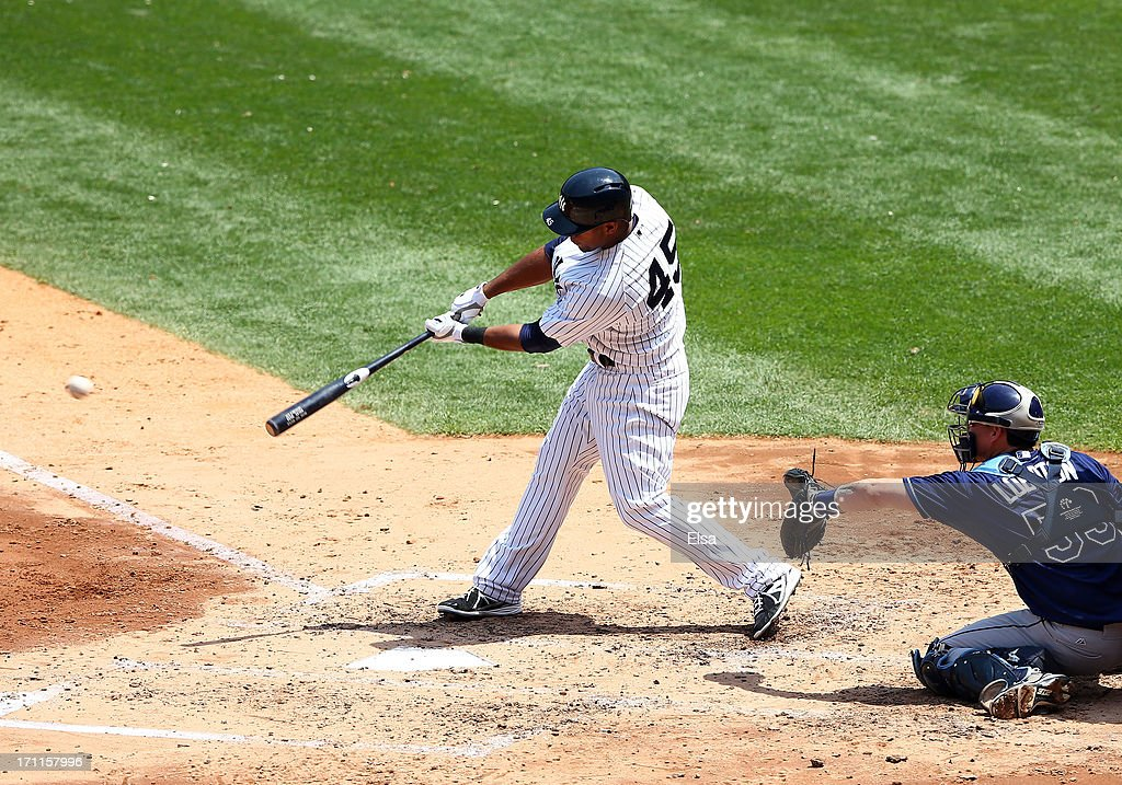 Zoilo Almonte #45 of the New York Yankees hits a 2 RBI double against the Tampa Bay Rays on June 22,2013 at Yankee Stadium in the Bronx borough of New York City.