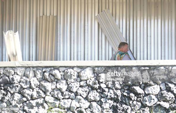 Zoli Bedo installs hurricane shutters at Dillon's Pub in Islamorada Florida on September 6 2017T he storm has grown to a category 5 and is expected...