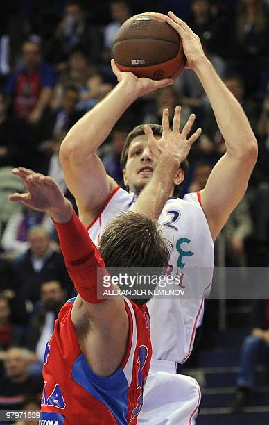 Zolran Planinic of CSKA fights for the ball with Mirza Teletovic of Caja Laboral in Moscow on 23 March 2010 during their Euroleague quarterfinal...