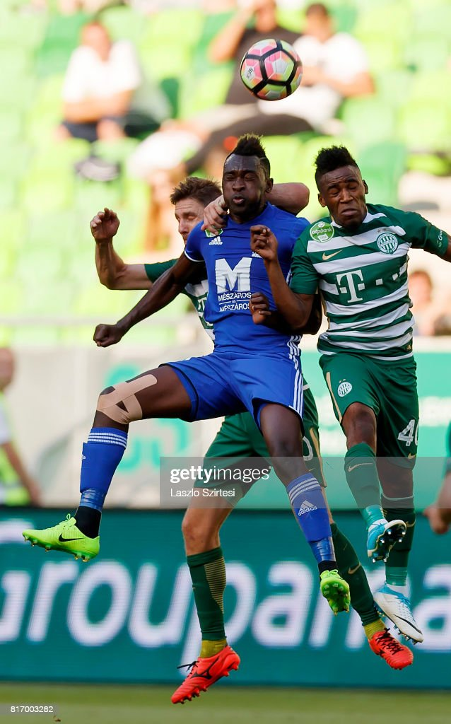 Zoltan Gera (L) of Ferencvarosi TC and Amadou Moutari #40 of Ferencvarosi TC compete for the ball in the air with Ulysse Diallo (R2) of Puskas Akademia FC during the Hungarian OTP Bank Liga match between Ferencvarosi TC and Puskas Akademia FC at Groupama Arena on July 16, 2017 in Budapest, Hungary.